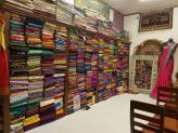 One of the tuk tuk stop shops - saris and pashminas from floor to ceiling