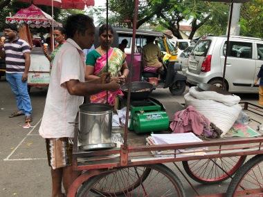Street vendor roasting peanuts